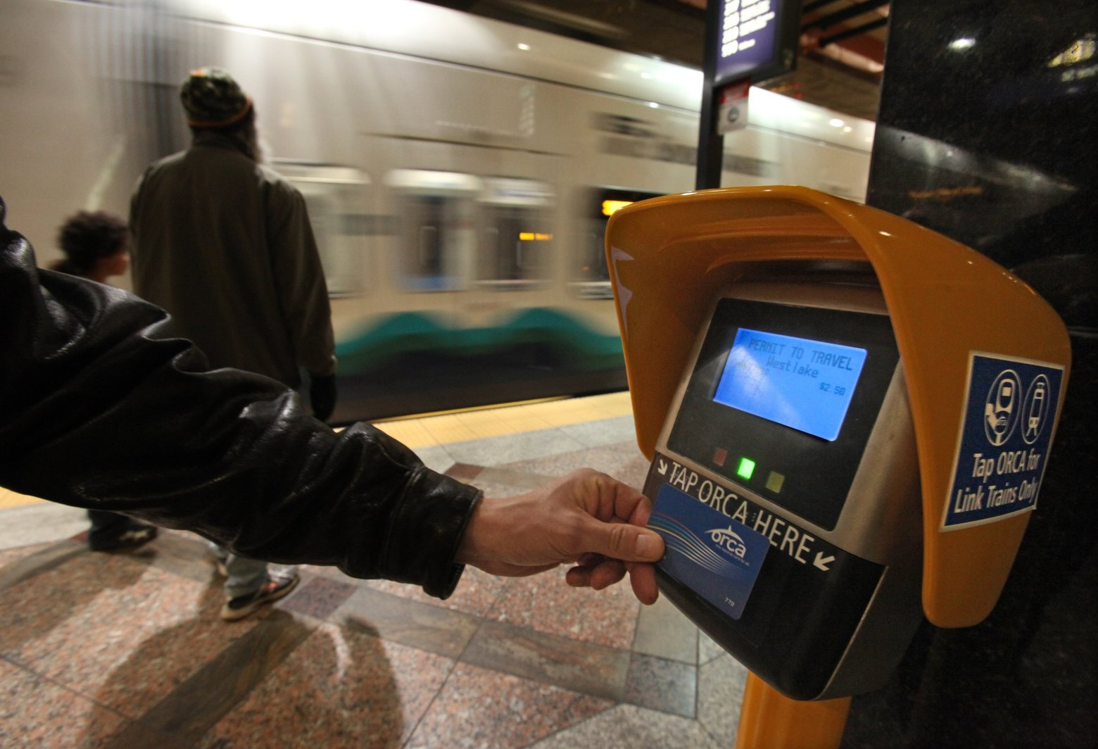 Sound Transit's sharing of the cardholders' information with the ST3 campaign may violate two state laws. Shown is an Orca card reader in downtown Seattle. (Steve Ringman / The Seattle Times)