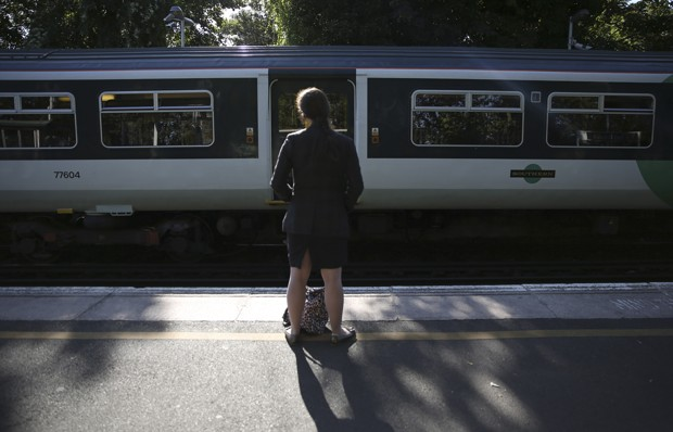 A passenger waits for a train at Dulwich East station in London, Britain August 9, 2016. REUTERS/Neil Hall - RTSM132